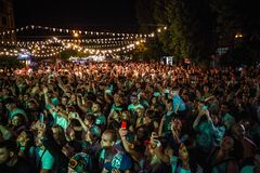 Summer music festival crowd partying outdoor. KIEV-11 JULY,2018: Group of young people partying on summer hip hop music festival Bazar outdoor.Concert crowd royalty free stock photos