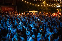 Summer music festival crowd partying outdoor. KIEV-11 JULY,2018: Group of young people taking photos with smart phones on summer music festival Bazat at night royalty free stock images