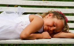 Summer nap. A young girl taking a cat nap in the sun royalty free stock photo