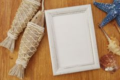 Summer navy background, photo frame and various marine design elements. On wooden background royalty free stock image