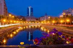 Summer night in Bucharest. View of old and new Bucharest from the bank of Dambovita River royalty free stock photos