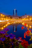 Summer night in Bucharest. View of old and new Bucharest from the bank of Dambovita River royalty free stock image