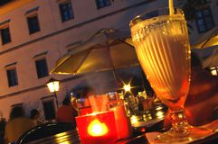 Summer Night with Candle Light. Summer night with milk shake and candle light in a local garden in Linz/Upper Austria Stock Photo
