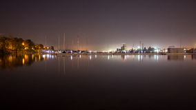 Summer night city light reflections over water Stock Photos