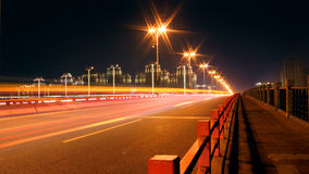 Summer night resplendent brilliant light. Summer night, the street lamp radiation light, light glowed with a light path, lit up the bridge deck, beautiful night Stock Image