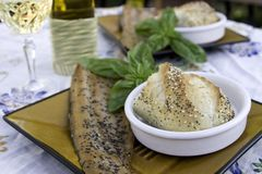 A Summer Night's Snack. Freshly prepared trout and fresh bread await diners on a summer evening Stock Photography