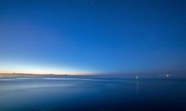 Summer night sea sky after sunset. Stars. Summer night sea sky after sunset. city light and stars Stock Image