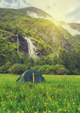 Summer at Norway camping. Tourist tent in the Norway mountains at sunrise Royalty Free Stock Photos