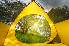 Summer at Norway camping. View from tourist tent in the Norway mountains at sunrise Royalty Free Stock Photography