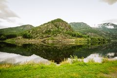 Summer Norwegian mountain landscape reflected in water royalty free stock photo