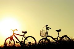 Bikes at sunset. Summer nurture and yellow sky. bikes at sunset royalty free stock photos