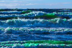 Summer ocean waves. Summer ocean beach with green waves at sunny day stock photo