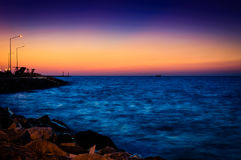Summer Ocean Sunset Scenery. Epic and poetic summer scenery on an island in the sunset with clear sky and open horizon in the distance Royalty Free Stock Image