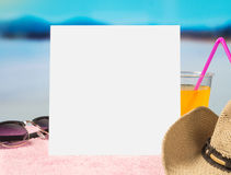 Summer offer background template for promotion and sales. Sunglasses, cocktail and brimmed hat on towel with beautiful paradise. Stock Photography