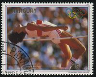 Summer Olympic Games in Los-Angeles. RUSSIA KALININGRAD, 19 APRIL 2017: stamp printed by Paraguay, shows high-jumper, gold medalist at Summer Olympic Games in Royalty Free Stock Photos