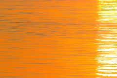 Summer orange natural background. Quiet beautiful golden sunset on the sea