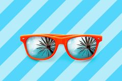 Summer Orange Sunglasses With Palm Trees Reflections Isolated In Blue Background With Diagonal Stripes Royalty Free Stock Photo