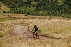 Summer outdoor activities. Cycling in fields and hills stock images