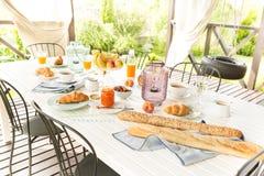 Summer outdoor continental breakfast on the garden terrace Stock Images