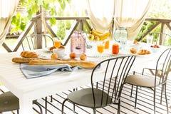 Summer outdoor continental breakfast on the garden terrace Stock Photos