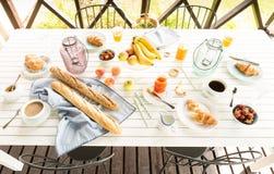 Summer outdoor continental breakfast on the garden terrace Stock Photo
