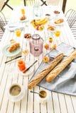Summer outdoor continental breakfast on the garden terrace Stock Photography