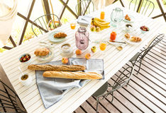 Summer outdoor continental breakfast on the garden terrace Royalty Free Stock Photography