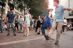 Summer outdoor dancing in Playhouse Square in downtown Cleveland, Ohio, USA. Each summer, for 13 weeks, Cleveland residents take to the streets downtown for the royalty free stock photos