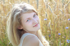 Summer outdoor headshot portrait of blonde girl at. Grain ears field floral background stock photo