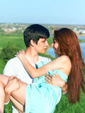 Summer outdoors portrait of young sensual couple Stock Image