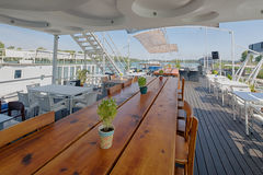 Summer outdor restaurant on the river bank Royalty Free Stock Image