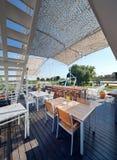 Summer outdor restaurant on the river bank Stock Photos