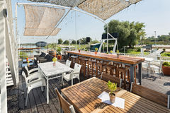 Summer outdor restaurant on the river bank Royalty Free Stock Photo