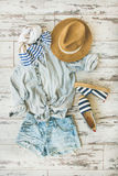 Summer outfit flatlay, parquet background, top view stock photos