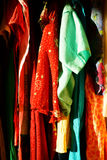 Summer outfits hanging in closet Royalty Free Stock Images