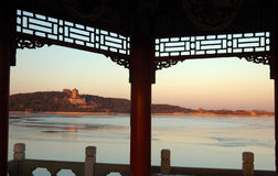 Summer Palace. The pavilion at the western bank frames a picture of Summer Palace at sunset time. Summer Palace, Beijing, China royalty free stock photography