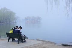 Summer Palace,Beijing,China. A tourist resting on a bench in the Summer Palace Stock Photography