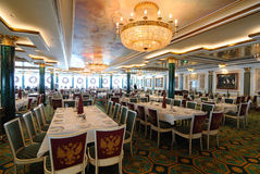 Summer Palace Dining Hall. Summer Palace, An elegant Russian inspired dining hall aboard the Norwegian Pearl cruise ship Royalty Free Stock Image
