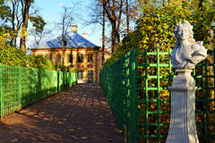 Summer palace and marble bust  in Summer garden. Stock Image