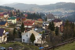 Summer panorama, Bukovel ski resort village in Carpathian mountains in Ukraine. Top view of residential houses, cottage under. Construction and hotels on bright stock photo