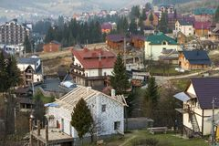Summer panorama, Bukovel ski resort village in Carpathian mountains in Ukraine. Top view of residential houses, cottage under. Construction and hotels on bright stock images