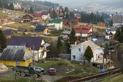 Summer panorama, Bukovel ski resort village in Carpathian mountains in Ukraine. Top view of residential houses, cottage under. Construction and hotels on bright royalty free stock photography