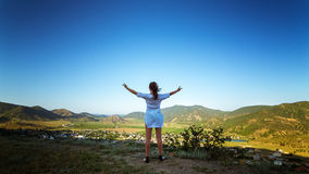 Summer panorama of the Crimea with hills and with a girl, Russia Royalty Free Stock Photo