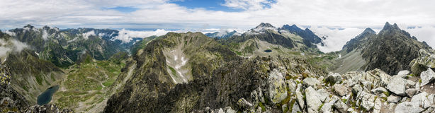 Summer panorama of mountains - valleys and ridges. Royalty Free Stock Image