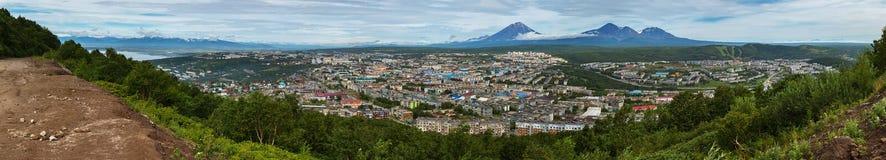 Summer panorama of Petropavlovsk-Kamchatsky on background Avachinskaya group Volcano. View from Mishennaya hills. Royalty Free Stock Photo