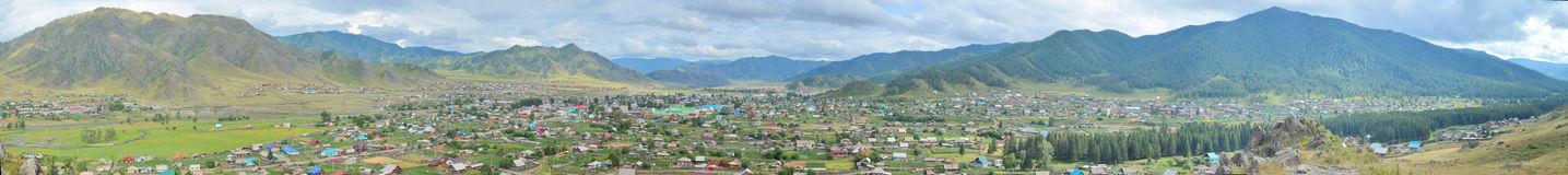 Summer panorama of the village Ongudai, Altai Siberia, Russia Stock Photography