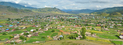 Summer panorama of the village Ongudai, Altai Siberia, Russia Royalty Free Stock Image