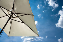 Summer parasol. A parasol with blue sky and clouds Royalty Free Stock Image