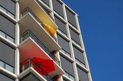 Summer parasols. Some parasols on a modern building Stock Images