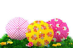 Summer parasols in grass Stock Images